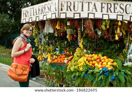 beautiful smiling tourist at a local market in Rome, Italy - stock photo