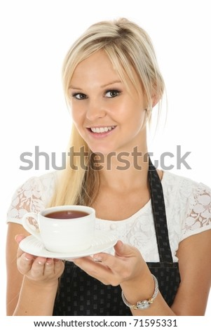 Beautiful smiling waitress with a cup of hot tea - stock photo