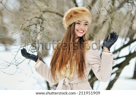 Beautiful smiling winter girl - outdoor portrait - stock photo