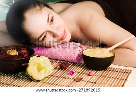 Beautiful smiling woman at a spa salon - stock photo