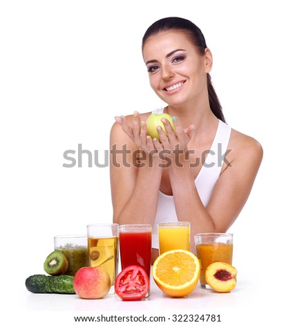 Beautiful smiling woman holding a ripe apple. Diet and vegetarian concept - happy woman with healthy food on an isolated white background. - stock photo