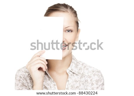 beautiful smiling woman holding a white card, covering her eyes - stock photo
