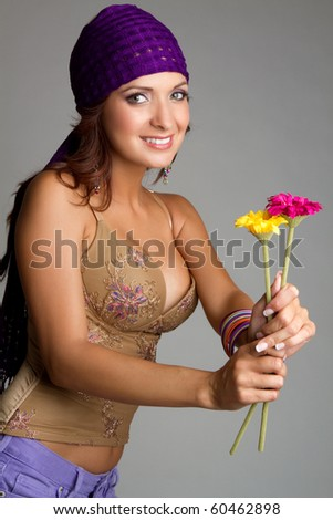Beautiful smiling woman holding flowers