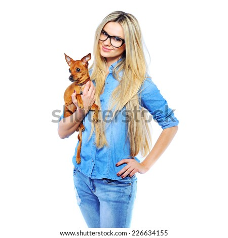 Beautiful smiling woman holding her little puppy isolated on while - stock photo