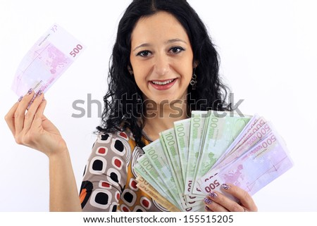 Beautiful smiling woman holding money in hand