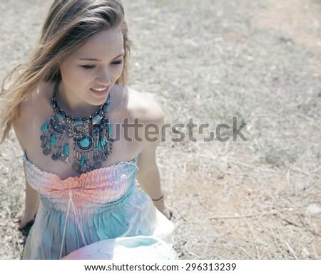 beautiful smiling woman in a nature.  Autumn portrait. outdoors shot, Horizontal. - stock photo
