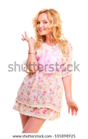 Beautiful smiling woman in a pink dress high-key portrait. isolated on a white background