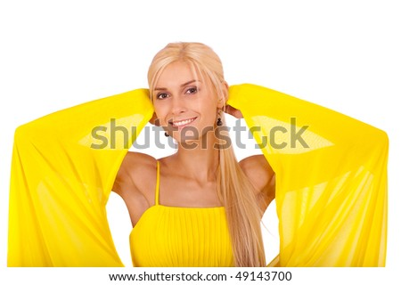 Beautiful smiling woman in yellow dress, isolated on white background.