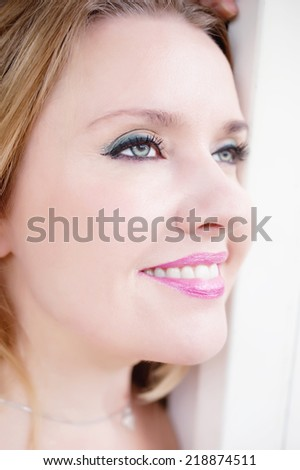 Beautiful smiling woman looking away - stock photo