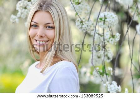 Beautiful smiling woman portrait close up  - stock photo