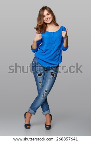 Beautiful smiling woman standing in full length over white background and giving double thumb up - stock photo