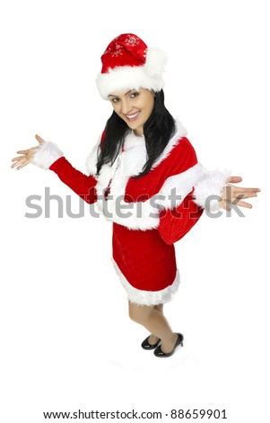 Beautiful smiling woman wearing santa clause costume - stock photo