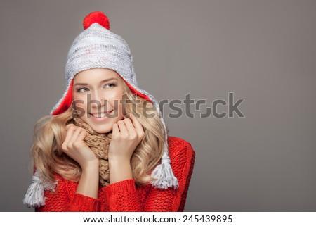 Beautiful smiling woman wearing winter clothing. - stock photo