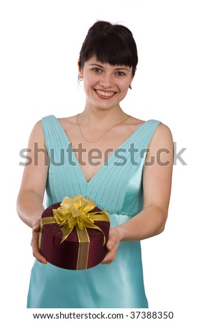Beautiful smiling woman with a gift.  Girl in greenness of the sea dress is standing and holding purple box with gold ribbon on white background.