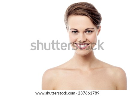 Beautiful smiling woman with bare shoulders - stock photo