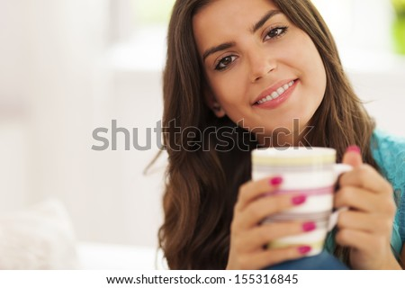 Beautiful smiling woman with cup of coffee