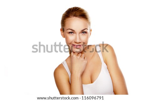 Beautiful smiling woman with dreamy expression resting her chin on her hands isolated on white