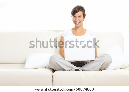 Beautiful smiling woman with laptop  at home - stock photo