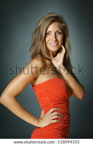 Beautiful smiling woman with long strong hair - stock photo