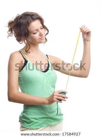 beautiful smiling woman with measure - stock photo