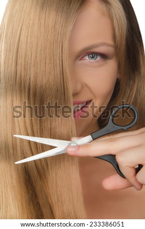 Beautiful smiling woman with straight hair and scissors - stock photo