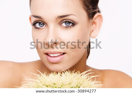 Beautiful Smiling Woman with the cactus plant - stock photo