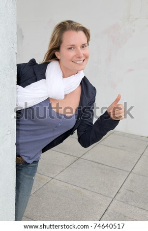 Beautiful smiling woman with thumb up - stock photo