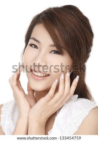 Beautiful smiling young adult face with hand at face