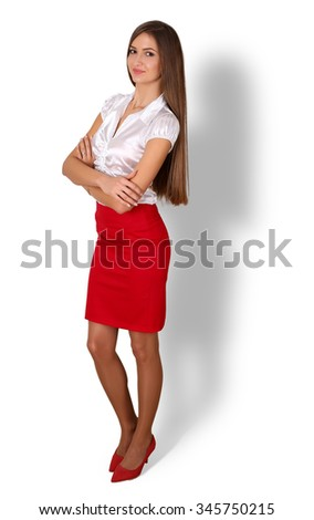 Beautiful smiling young brunette businesswoman with long hair standing full length portrait isolated on white background with shadow. Business success, education, banker or financier concept - stock photo