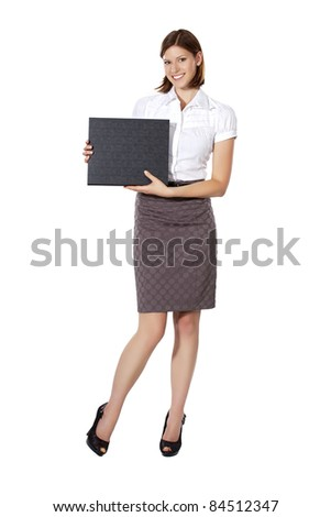 Beautiful smiling young businesswoman holding a sign in both hands - stock photo