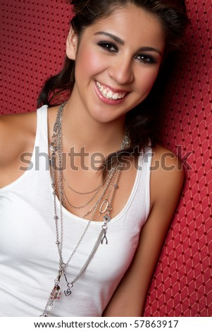 Beautiful smiling young hispanic girl - stock photo