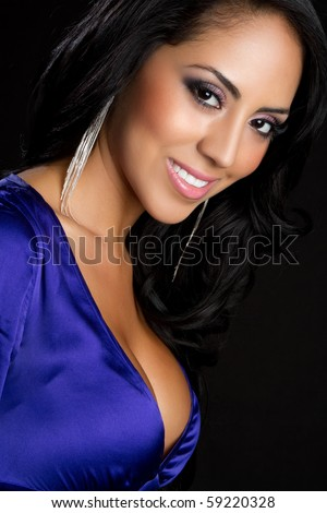 Beautiful smiling young latina woman - stock photo