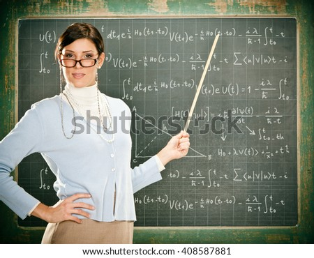Beautiful smiling young teacher with glasses and blackbouard