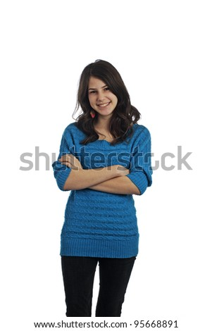 Beautiful smiling young teenage girl with long dark brown hair and arms crossed. Isolated on white background, vertical format with copy space.