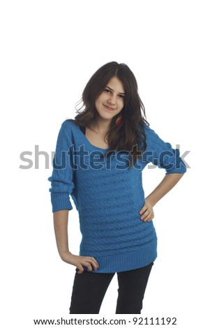 Beautiful smiling young teenage girl with long dark brown hair and hand on hip. Isolated on white background, vertical format with copy space.