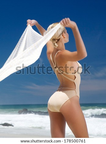 Beautiful Smiling Young Woman Blowing Light Cloth In The Breeze - stock photo