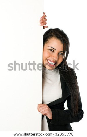 Beautiful smiling young woman holding a blank sign to write it on whatever you want! - stock photo