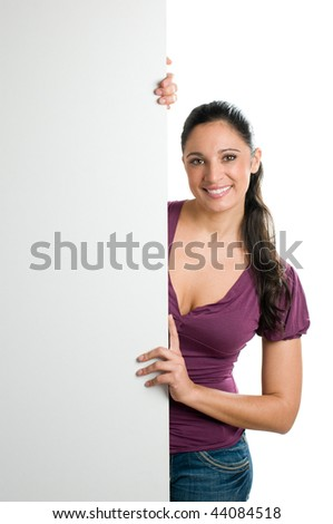 Beautiful smiling young woman holding a blank signboard to write it on whatever you want!