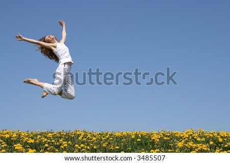 Beautiful smiling young woman in a happy jump. - stock photo