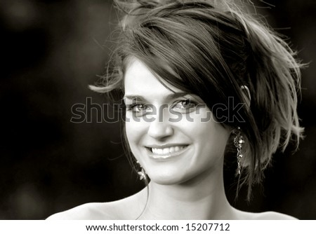 Beautiful smiling young woman with background 04. Black & White version - stock photo