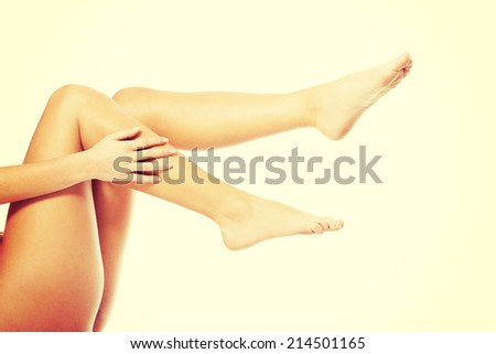 Beautiful, smooth female legs and feet. Isolated on white. - stock photo