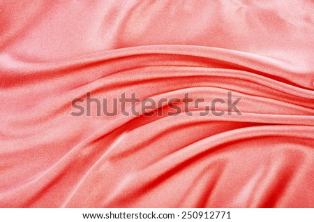 Beautiful smooth red silk, drapery textile background - stock photo