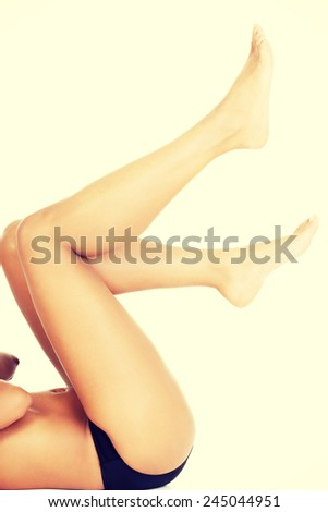Beautiful smooth slim and shaved legs.  - stock photo