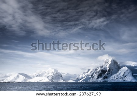 Beautiful snow-capped mountains against the blue sky
