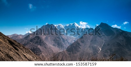 Beautiful snow-capped mountains against the blue sky. Himalaya, Nepal - stock photo