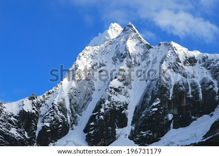 Beautiful snow covered mountain peaks in the Cordillera Blanca range of Huascaran National Park, Peru  - stock photo