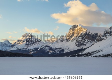 Beautiful snow covered mountain with morning sunlight hitting the peak. Taken at Bow Lake, Icefields Pkwy, Alberta, Canada. - stock photo