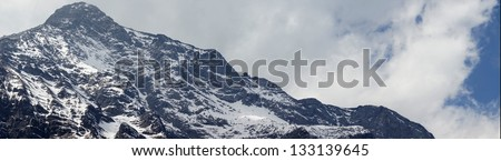 beautiful snow mountain with clouds and fog - Jade Dragon Snow Mountain or Mount Yulong in Lijiang, Yunnan province - stock photo