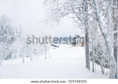 Beautiful snow view on hills nature of Lapland Finland north with trees - stock photo