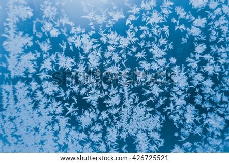 Beautiful snowflake on the window, winter fairytale. Texture  - stock photo